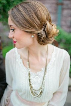 Cute and classy twisty side bun. Love the cool dark blonde colour as well.