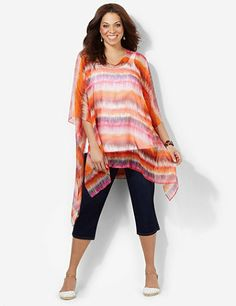 Electric Sunset Poncho: Electrify your look with our silky, sheer poncho in a vibrant, color-rich ikat print. V-neckline. Asymmetrical hem. Catherines tops are designed for the plus size woman to guarantee a flattering fit. catherines.com #catherines #springstyle #plussizestyle