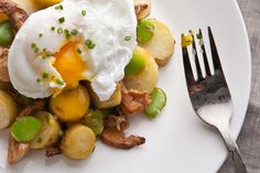 A warm salad of new potatoes, fava beans, and chanterelles is hearty enough to be a main dish when topped by a poached egg with a molten yolk