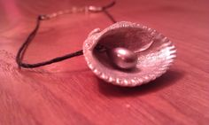 Painted shell, with teardrop necklace