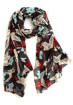 ModCloth has the best casual scarves, at the best prices. The red and turquoise would really pop against black, white, or yellow.