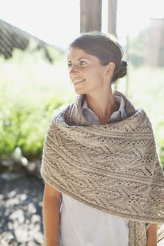 This luxurious wrap features a stunning Japanese lace and cable motif. The pattern is written for multiple sizes and functions, ranging from a standard scarf to a dramatic, large wrap. Each piece is worked flat, alternating RS and WS rows throughout. Blocking wires are recommended for best results in achieving crisp, clean edges during finishing. $7 knitted pattern.