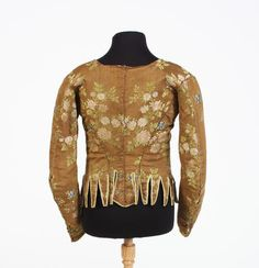 Provincial bodice, early 18th century. Brown silk, embroidered with pink and blue flowers and green foliage, central hook and eye fastening.