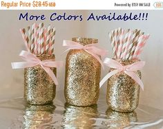 This listing will provide you with a set of 3 glass glitter mason jars decorated with gold glitter and satin bows around the mouth of the jar. limited quantities available of this set. In this set you will receive 2 pint sized jars and 1 quart sizes jar. Choose a different color paper straw combo and ribbon color. Gold Straws may vary in design depending on what is in stock (stripes, polka dot, and chevron combos!) Ribbon color available options: Light Pink, Bright Pink, Blue, Red, Yell...