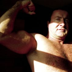 musclebear dad flexing biceps GLOBALFIGHT DVDs
