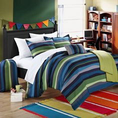 An on-trend striped pattern in shades of blue, grey and green add exciting style to the Kyle dorm room bedding set. Complete with a comforter, sheets and pillowcases and shams, this set also features a convenient throw blanket and laundry bag.