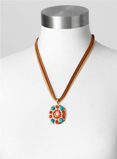 This colorful necklace mixes metal and faux leather strands with a bead-accented pendant for style that really stands out.