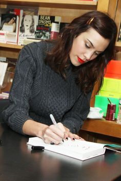 A side-pinned style for a New York signing of her book, [i]It[/i].