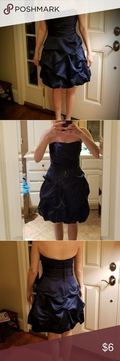 David's Bridal Strapless Navy Blue dress Just in time for Prom!! Worn only once for a wedding. Size 2. Navy blue. True to size with no alterations. Kept in plastic hanging up. Perfect condition! Strapless but feels extra secure. This dress will NOT disappoint! Dress style number 84091 from David's Bridal. David's Bridal Dresses Prom