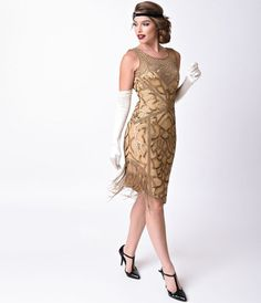 Gilda is going to do what she pleases, dear! A striking flapper that can only be found at Unique Vintage, complete in devastating antique gold sequin and beaded deco designs. Given a modern fit while preserving vintage verve, The Gilda Flapper captures li