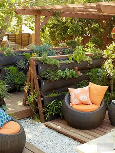 """The various outdoor rooms are connected by verdant """"hallways"""" created using custom A-frame wooden fences and breathable vertical planters filled with edible plants. Backyard Garden Landscape, Small Backyard Gardens, Modern Backyard, Backyard Retreat, Backyard Patio, Outdoor Gardens, Large Backyard, Backyard Ideas, Garden Landscaping"""