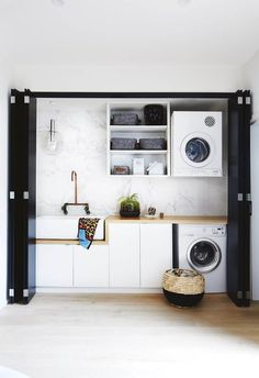 This creative couple proves size doesn't matter in their transformation of a tiny cottage on a compact block. Here, we take a closer look at all the design details and heavenly homewares we want to steal for our own homes. Laundry In Kitchen, Laundry Cupboard, Modern Laundry Rooms, Laundry In Bathroom, Utility Cupboard, European Laundry, Engineered Timber Flooring, Hidden Laundry, Compact Laundry