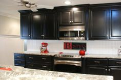 Love the black cabinets and beadboard.  = = = Addicted to Decorating - Julia's Kitchen