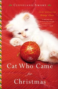 The Cat Who Came for Christmas by Cleveland Amory http://www.amazon.com/dp/0316242683/ref=cm_sw_r_pi_dp_XDUawb0KY9CDM