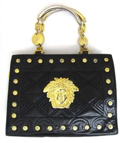 Vintage Gianni Versace black leather tote bag with big golden medusa charms, and gold tone hardwares