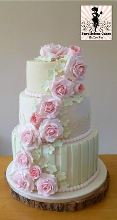 White Three-Tiered Wedding Cake ... with GORGEOUS Pale Roses as a Garland from Top to Bottom FROM: CakesDecor
