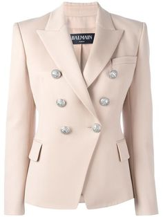 Balmain double breasted blazer features peaked lapels, a double breasted front fastening, a chest pocket, two front pockets, shoulder pads, long sleeves and button cuffs.