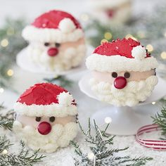 A photo showing a group of Santa cupcakes on a white marble table with greenery. Christmas Deserts, Christmas Party Food, Xmas Food, Christmas Cooking, Christmas Goodies, Holiday Desserts, Holiday Baking, Holiday Treats, Holiday Recipes