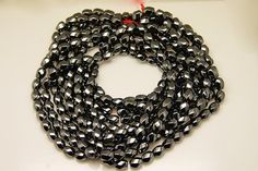 1strand  natural hematite twisted post sized 9 by 12mm by 3yes