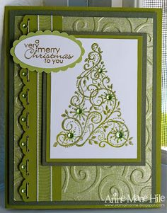 Monochromatic Green Christmas Card with Stamped swirly tree back with a swirly embossing folder design.