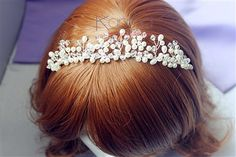 A beautiful fresh water pearl bridal tiara. It makes an elegant bridal halo, wreath or crown, with a silver wire band for styling convenience. - Karmabridal.com