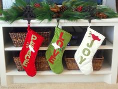 Or pretend your TV stand is your mantle so you can use your favorite stocking hooks. | 15 Borderline Genius Christmas Decorating Ideas For Your Tiny Space
