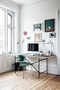 vintage modern home office with minimalist vibe. great green chair and gallery wall. #workspace