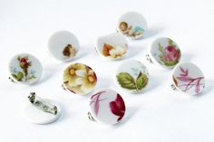 These ceramic badges and pendants are made out of old, neglected porcelain plates