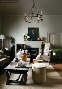 Another idea that I like is the wing-tipped chairs(I believe my husband likes this chairs) in front of the fireplace.