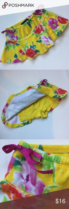 Ralph Lauren girls terry cloth floral skirt so 2T Ralph Lauren girls terry cloth floral skirt. Size: 2T. Yellow with multi colors floral print. Side purple ribbon ties. Shorts attached underneath. Great preowned condition. Adorable! Ralph Lauren Bottoms Skirts