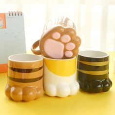 Purrty Paw Cat Coffee Cup, Tea Or Soup Mug: These adorable ceramic cat paw mug is perfect for drinking your morning coffee or tea from and you can even use it for soup! This mug holds approximately 250 ml and is microwave and dishwasher safe. Makes a great office coffee mug, birthday gift and even a Christmas gift. Grab an extra one so you can share with a friend!