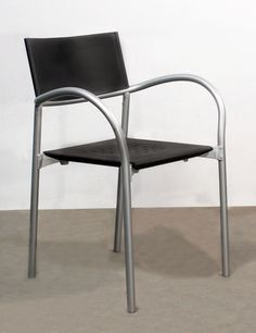 Carlo Bartolli Breeze Stack Chair This durable chair can be in the office, break room or as a side chair. The flexible vinyl material is very easy to clean and durable. Color: Black with brushed ni…