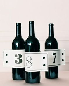French-Cuff Wine Bottles:   Dress your wine bottles with table number labels that mimic shirt cuffs.     The Details: Cuff-link knots, Pacific Trimming.