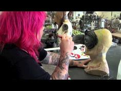 China Horrell is an artist at Specter Studios who paints and customizes delightfully horrific masks and props. In this video portrait, China shows us a gruesome, mounted Tickle Me Elmo, paints a mask before our very eyes, and tells us a personal story that illustrates the dire need for health care reform.
