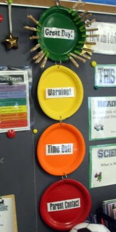 Classroom behavioral management idea. I wonder if I could do this with my high schoolers?? Of course without the time out. I would use just the green, yellow and red. That way they can see where they stand for the day
