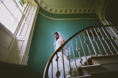 Michelle walking down the stairs at Taitlands to her ceremony - Sansom Photography