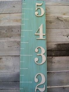 Growth Chart. I would have this free standing in the living room and on the back make the marks of how tall the kids are. That way you can take it with you from house to house and the pencil marks don't mess up the front. Cute!