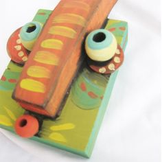 scrap wood..fabulous - awesome!  I have these beads...garden art workshop?