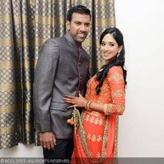 Lakshmipathy Balaji and Priya Thalur pose for the cameras ahead of their reception party, held in Chennai