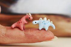 Firefly tiny dinosaurs - miniature allosaurus and stegosaurus
