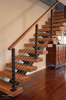 Floating Stair DIY Install This New York FLIGHT features a custom stringer, quarter-sawn clear-coated white oak treads, and black aluminum cable railing posts. The homeowner was able to install the project by himself with the help of a frie The Loft, Cable Stair Railing, Staircase Railings, Staircase Ideas, Rustic Stairs, Modern Stairs, Stair Kits, Home Stairs Design, Staircase Design Modern