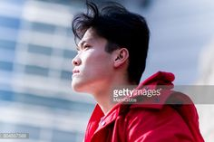 Stock Photo : Young man looking up the sky
