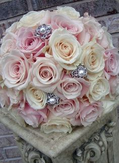 Rose with a little sparkle bouquet. This would also be easy as a DIY. Gather roses, beginning with center, add stick pins, wrap stems in lace.