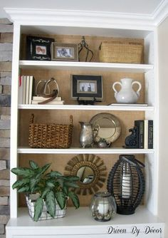 Add texture and warmth by placing burlap on the back of a white bookcase. I love how it highlights what's on the shelves! I also really like the molding to give the bookcase that built in look Styling Bookshelves, Built In Bookcase, Bookcases, Bookshelf Decorating, Arranging Bookshelves, Rustic Bookshelf, Fireplace Bookshelves, Bookshelf Ideas, Bookcase Shelves