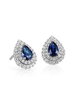 Captivating and exotic, these sapphire and diamond earrings feature vibrant pear-cut sapphires surrounded by double diamond halos.