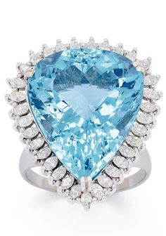 An Aquamarine and Diamond Ring Set with a pear-shaped aquamarine weighing approximately 40.00 carats, surrounded by marquise-cut diamonds, mounted in 18k white gold, size 12 3/4