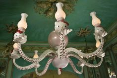Octopus Chandeliers by Adam Wallacavage. Check out his web page: Check out his web page: http://www.adamwallacavage.com/  Thank you to The Mary Sue for great pic's.