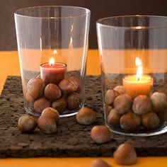 A vase filled with acorns and a simple candle #centerpiece #fall