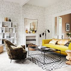 Living room with damask wallpaper and armchair // living room
