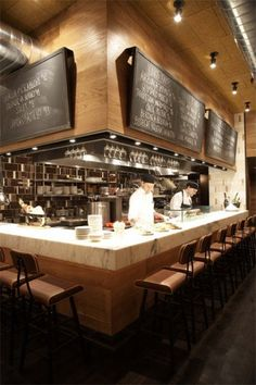 open kitchen design with lots of bar seating, chalkboard menus
